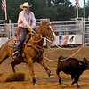 Nathan Ponder, of Afton, Okla., competes in the calf roping competition on Friday night at the Columbus Saddle Club Rodeo in Columbus.<br /> Globe | Laurie Sisk