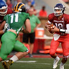 Pittsburg quarterback Chase Curtis looks for room to run as Garrett Bridwell pursues during the first quarter of the Kansas Shrine Bowl on Saturday night at Carnie Smith Stadium.<br /> Globe | Laurie Sisk