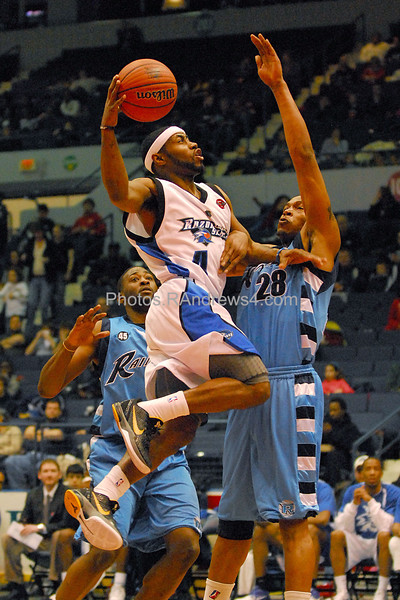 Rochester Razersharks Jerice Crouch, center, goes up for a shot while Halifax Rainmen Julian Allen, right, defends during the basketball game at Blue Cross Arena on Saturday February 19, 2011. Photo by Ron Andrews.