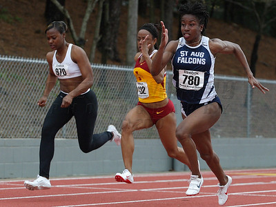 Barbara Pierre, of St. Augustine's College and sprinter on Haitian Olympic team, sprints to win her heat of the 100m.
