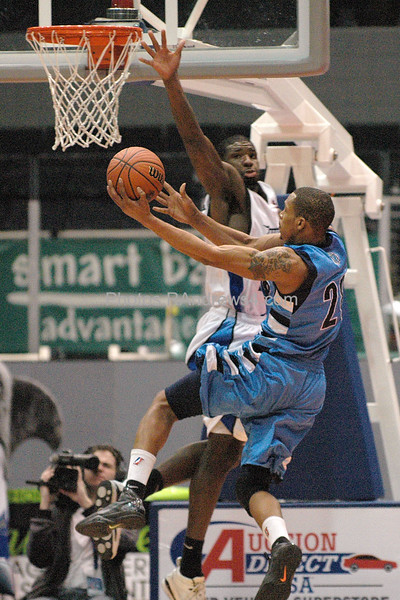 Rochester Razersharks Mike Williams, left, goes up to block the shot of Halifax Rainmen Julian Allen, right, during the basketball game at Blue Cross Arena on Saturday February 19, 2011. Photo by Ron Andrews.