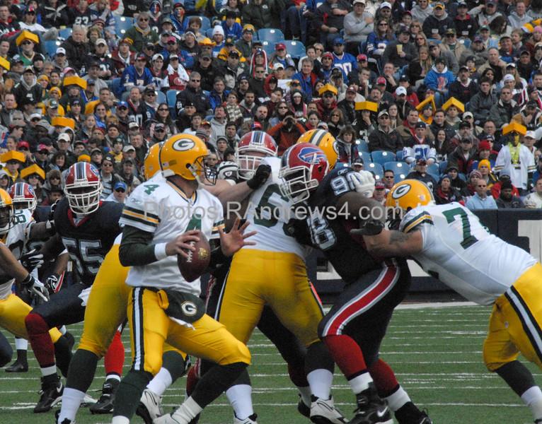 Brett Favre drops back to pass as Larry Triplett (98) of the Buffalo Bills breaks through the line on November 5, 2006.