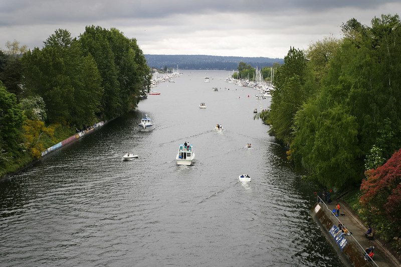 In Seattle, every year, Opening Day in May marks the start of the annual boating season on Lake Washington with crew races and a long boat parade through the ship canal. Coincidentally, it is usually cloudy too!