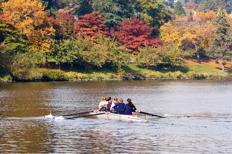 A boat of women rowers preparing for a race in the fall on Lake Washington.