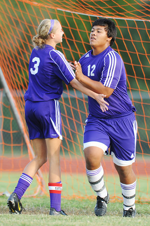 Globe/T. Rob Brown<br /> Pittsburg (Kan.) High School's Gershom Avalos (12) and Moira Myers (3) celebrate at the goal after Pittsburg scored the 10th and final goal against Thomas Jefferson Independent Day School Thursday evening, Sept. 20, 2012, during the second half at Thomas Jefferson's soccer field.
