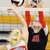 Globe/T. Rob Brown<br /> Carl Junction's Hope Joyner braces as she attempts to block a shot from Webb City's Jessica Heuertz Saturday, Sept. 22, 2012, during a tournament at Carl Junction High School's gymnasium.