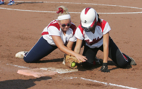 Globe/Roger Nomer<br /> Carl Junction's Bryce Boyd tags the bag safely under Joplin's Ashlie Green's pickoff attempt during the first game on Tuesday at the Joplin Athletic Complex.
