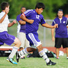 Globe/T. Rob Brown<br /> Pittsburg (Kan.) High School's Gershom Avalos (12) drives the ball toward the goal, as Thomas Jefferson Independent Day School's Trevor Spriggs trails, just before Pittsburg scored the 10th and final goal Thursday evening, Sept. 20, 2012, during the second half at Thomas Jefferson's soccer field.
