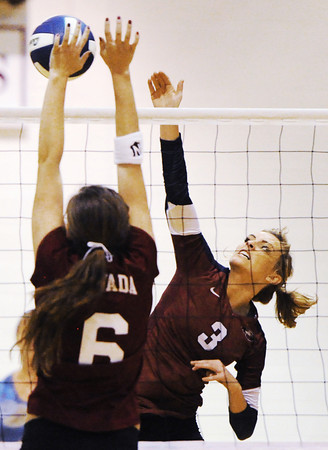 Globe/T. Rob Brown<br /> Joplin's Leah Rader attempts a shot past Nevada's Megan Mason during a varsity volleyball match Tuesday night, Sept. 25, 2012, at Joplin Memorial Middle School's gymnasium. Joplin won the first game 26-24.