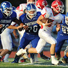 Globe/Roger Nomer<br /> The Carthage defense closes in on Carl Junction's Nick Thompson during Thursday's game in Carthage.