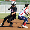 Globe/T. Rob Brown<br /> McDonald County runner Kelsey Reynolds slips past Joplin infielder Kristen Tyler during a play at second Tuesday afternoon, Sept. 11, 2012. The runner was called safe.