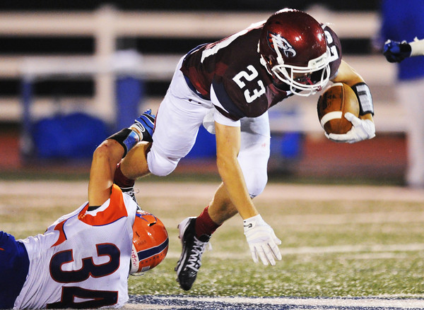 Globe/T. Rob Brown<br /> Joplin's Gavin Jones gets tripped up by Hillcrest's Sheldon Moeller during Friday night's game, Sept. 7, 2012, at Joplin's Junge Field.