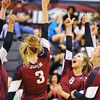 Globe/T. Rob Brown<br /> Joplin varsity volleyball players celebrate during a game against Nevada Tuesday night, Sept. 25, 2012, at Joplin Memorial Middle School's gymnasium. Joplin won the first game 26-24.