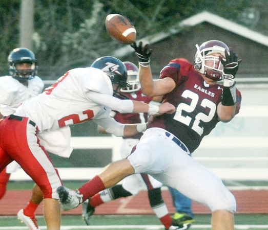 Globe/Roger Nomer<br /> West Plains' Nick Barslow hits Joplin's Adam St. Peter to break up a pass in the first quarter of Friday's game at Junge Stadium.