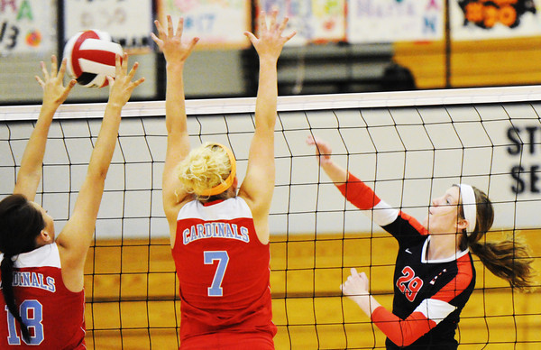 Globe/T. Rob Brown<br /> Carl Junction's Maria Chism fires the ball past Webb City's Sadie Flood (18) and Jessica Heuertz (7) Saturday, Sept. 22, 2012, during a tournament at Carl Junction High School's gymnasium.