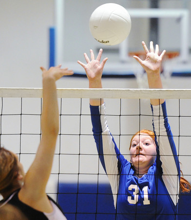 Globe/T. Rob Brown<br /> McAuley Catholic High School's Kathryn Wiseman attempts to block a kill attempt by Thomas Jefferson Independent Day School's Kaylee Connor Thursday night, Sept. 13, 2012, at McAuley's gymnasium.