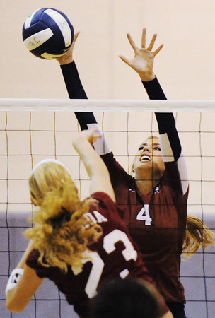 Globe/T. Rob Brown<br /> Joplin's Jacqueline Lieurance leaps up to block a shot attempt by Nevada's Regan Kannady during a varsity volleyball match Tuesday night, Sept. 25, 2012, at Joplin Memorial Middle School's gymnasium. Joplin won the first game 26-24.