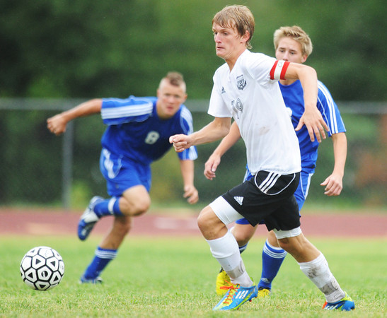 Globe/T. Rob Brown<br /> College Heights Christian School's Brantly Gossett, drives the ball around Riverton defenders Friday evening, Sept. 14, 2012, during the Thomas Jefferson 2012 Cavalier Soccer Classic. Gossett scored his 100th career goal in the game.