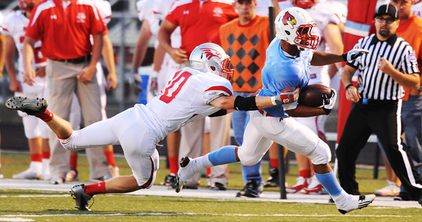 Globe/T. Rob Brown<br /> Nixa's Logan Ford grabs hold of Webb City runningback Phoenix Johnson Friday night, Sept. 21, 2012, at Webb City's football field.
