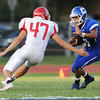 Globe/Roger Nomer<br /> Carthage's Seth Beckner tries to stiff arm Carl Junction's Tyler Armentrout during Thursday's game in Carthage.