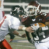 Globe/Roger Nomer<br /> Joplin's Chris Payton-Barba breaks past West Plains' Nick Barslow for big yardage to set up the Eagle's second touchdown of the game during Friday's game at Junge Stadium.