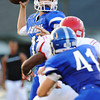 Globe/Roger Nomer<br /> Carthage's Jordan Musser spies an open man in coverage during Thursday's game in Carthage.
