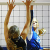 Globe/T. Rob Brown<br /> McAuley Catholic High School's Kenzie Doran attempts to get the ball past Thomas Jefferson Independent Day School's Kaylee Connor Thursday night, Sept. 13, 2012, at McAuley's gymnasium.