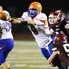 Globe/T. Rob Brown<br /> Hillcrest quarterback Jonah Hill attempts to get rid of the ball as Joplin defenders Jarad Bader (97) attempts to sack and Tucker Wallace (94) moves in to assist during Friday night's game, Sept. 7, 2012, at Joplin's Junge Field.