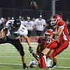 Globe/T. Rob Brown<br /> Lamar's Mark Bartlett blocks the point-after kick attempt by Carl Junction's Reece Tholen, held by Dustin Satterlee, Friday night, Sept. 28, 2012, at Carl Junction's football field.