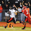 Globe/T. Rob Brown<br /> Lamar runningback Jared Beshore heads for the goal on a touchdown run as Carl Junction defender Matt Magee attempts a stop Friday night, Sept. 28, 2012, at Carl Junction's football field.
