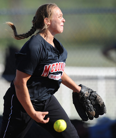 Globe/T. Rob Brown<br /> McDonald County pitcher Sarah Rickman hurls the ball toward the plate against Joplin Tuesday afternoon, Sept. 11, 2012.
