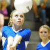 Globe/T. Rob Brown<br /> McAuley Catholic High School's Abby Pekarek sets the ball for a teammate's kill attempt as teammate Amber Cure (9) looks on from behind Thursday night, Sept. 13, 2012, as McAuley faced Thomas Jefferson Independent Day School at their home gymnasium.