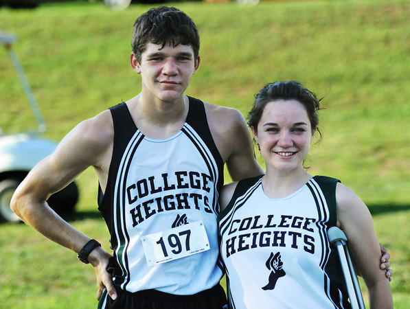Globe/T. Rob Brown<br /> College Heights Christian School senior Savannah Beaver, right, and her brother, junior Ryan Beaver, pose after Ryan Beaver came in 11th place at the Carthage Invitational cross country meet Thursday evening, Sept. 6, 2012.