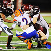 Globe/T. Rob Brown<br /> Joplin defenders Tucker Wallace (94), Keiondre Adams (21) and Rex Whisner (below) bring down Hillcrest wide receiver Matt Rush during Friday night's game, Sept. 7, 2012, at Joplin's Junge Field.