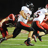 Globe/T. Rob Brown<br /> Lamar runningback Jared Beshore eludes the reach of Carl Junction's Calvin Bremmerkamp as Beshore's teammate Trenton Mooney (45) keeps Carl Junction's Matt Magee at bay Friday night, Sept. 28, 2012, at Carl Junction's football field.