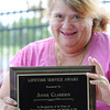 "Globe/T. Rob Brown<br /> Annie Clarkson holds the plaque, commemorating her 24 years of ""outstanding dedication and service to the Joplin Tennis Association,"" she received Saturday afternoon, Sept. 29, 2012, at the Joplin Athletic Complex tennis courts."