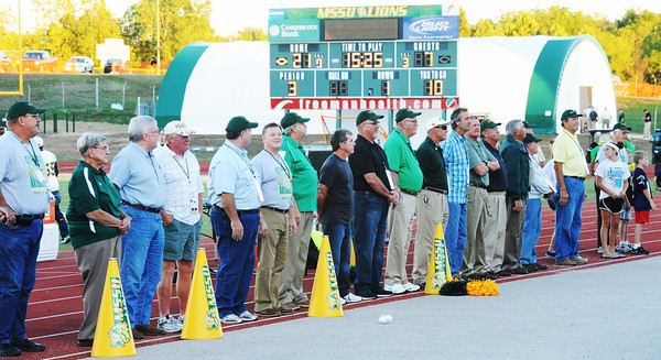 Globe/T. Rob Brown<br /> Members of the NAIA national championship football team are acknowledged Saturday evening, Sept. 8, 2012, during MSSU's football halftime at Fred G. Hughes Stadium.