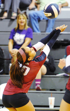 Globe/T. Rob Brown<br /> Joplin's Sidnee Palmer returns the ball to Nevada during a varsity volleyball match Tuesday night, Sept. 25, 2012, at Joplin Memorial Middle School's gymnasium. Joplin won the first game 26-24.