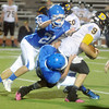 Globe/Roger Nomer<br /> McAuley's Ethan Freitas, bottom, and Anthony Bertoncino tackle Diamond's Brodie Bien during the second quarter of Friday's game at Fred G. Hughes Stadium.