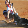 Globe/T. Rob Brown<br /> McDonald County runner Randi Davis and Joplin thirdbaseman Kelsey Gould look up to an official during a play at third Tuesday afternoon, Sept. 11, 2012. The runner was called safe.