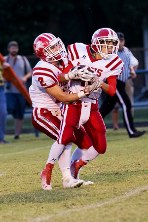 Globe/Israel Perez<br /> Lion's Dustin McDaniel (9) takes the ball from Nate Miller (2) during a return kick from the Rams.