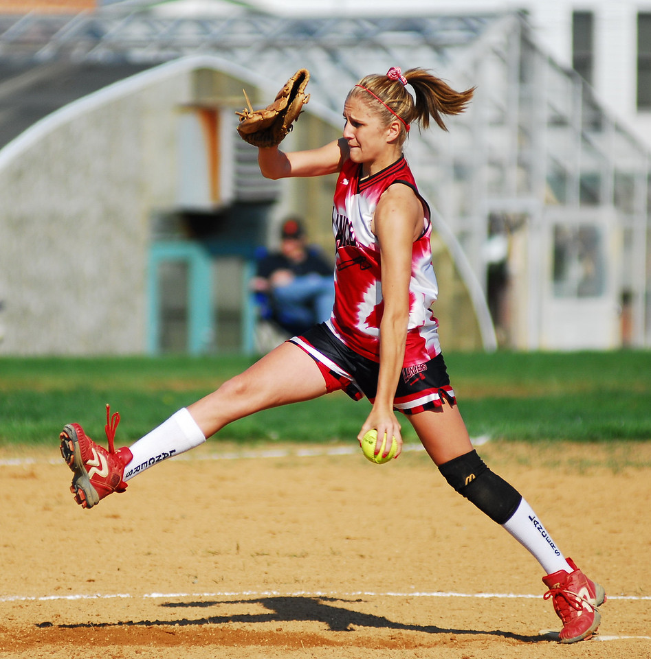 Linganore girl's softball team pitcher Julie Jones winds up and delivers a 47 mph fastball to a Westminster batter.