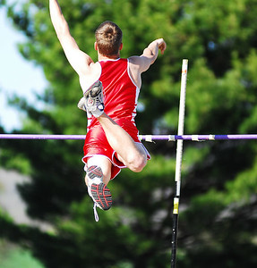 Thomas Johnson High School's Joe Thomas clears the 8 foot 6 inch mark by a mile to advance to the 2nd place position.