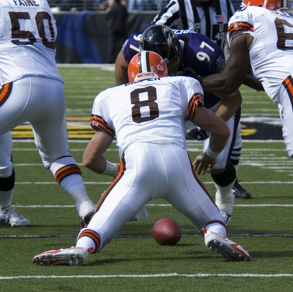 Cleveland Browns quarterback and ex-Baltimore Raven Trent Dilfer drops the ball on the snap but recovers for a loss of 5 yards.