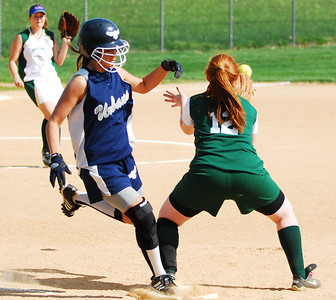Urbana batter Jill McCormick beats the throw to Century High Schools first basewoman Julie Smith.