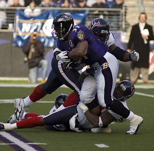 Baltimore Ravens running back Jamal Lewis attempts to break tackles to gain 5 yards against Houston Texans.