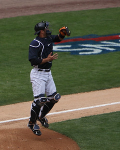 Jorge Posada takes throw to the plate from the outfield