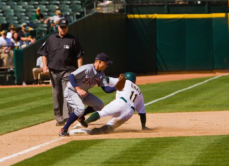 A's outfielder Rajai Davis steals third base against Detroit Tigers third baseman Brandon Inge, on 08/23/09