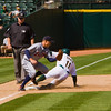 A's outfielder Rajai Davis steals third base against Detroit Tigers third baseman Brandon Inge, on 08/23/09