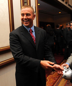 Kirk Herbstreit, former Ohio State player and commentator, signs an autograph at the Greater Cleveland Sports Awards Feb. 3.  He was emcee for the event.  Steve Manheim